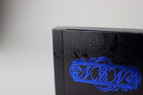 Name of the Wind Chandrian custom playing cards upclose on box texture.