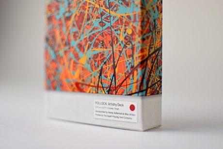 Pollock Artistry custom playing cards bottom half closeup of decksleeve.