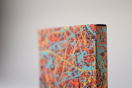 Pollock Artistry custom playing cards upclose of art on deck sleeve.